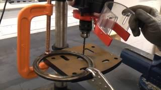 Drilling through hardened steel